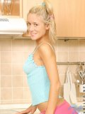 Naughty girl carrie has some fun in the kitchen playing and getting undressed there is something about kitchens