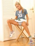 Crazy ass hottie carrie sits in her field hockey jersey and gets nice and topless for us
