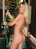 Adorable babe flaunts her perfect Nubile tits as she gets wet washing her car
