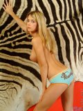 Horny nubile babe posing artistically indoors
