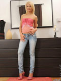 Alluring blonde Cherry Pink strips down her jeans and undies just to pleasure her craving fuck hole