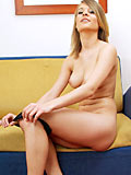 Gorgeous coolmona removes her clothes and getting naked on couch