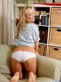 Cristal has some fun pulling off her cotton panties biting and stretching the band