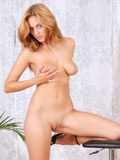 Topless amateur Daggy Jane gently squeezes her juicy bosoms and eagerly teasing us