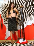 A very naked danica stands next to a wooden giraffe wtf yeah exactly