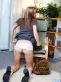 Cutie dina sits on a chair and spreads her legs ooh look cotten panties under her school skirt