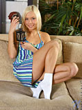 Check out Nubile Elga on the sofa as she uses her playful finger to satisfy her craving hot pussy