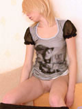 Heavenly teen  with shaved pussy and cute puffy tits pulls down her black pantyhose to display her tight virgin pussy