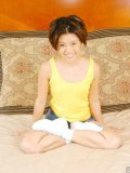 Cute small asian teen on bed topless with funny red panties