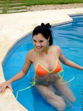 Florencia feels relax on pool unleash her top bikini and shows pinkish big tits