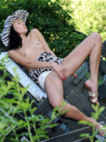 Naughty teen Gina Devine pleasures her pussy up skirt in the backyard