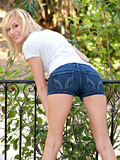 Blonde voyeuristic teen fingers her shaved pussy outdoors