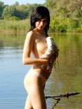 Alluring holly stripping all her clothes till gets totally naked in the lake