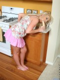 Seductive naughty teen siren toying her pussy with a suction cup dildo in the kitchen