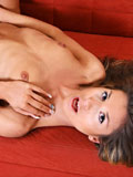 Tempting babe Ioana brags her slender hot frame and gives a mouthwatering pussy show on the couch