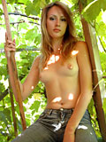 See jana under a leaf covered roof as the sunlight shines on her fresh nude body