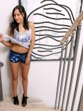 Pantyless chick Jenet in heels carelessly fucks sex toy on stairs