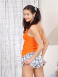 Cute teen jennifer has her long hair in pigtails as she gets more and more undressed