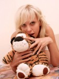 Naked nubile joanne simply covers her pink pussy with her cute toy