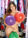 Long haired fresh teen posing just with balloons around her