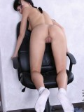 Lovely leggy hottie sitting on her office chair spreading her pussy