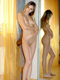 Fresh teen side by side mirroring her naked petite sweet body
