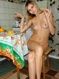 Katrina loves orange so much thats why she enjoys eating it while naked on kitchen