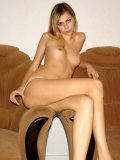 Slender teen nymph exposing her unbelievably curves on top or two chair