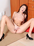 Beautiful Nubile Kattie Gold likes to play with her hairy pussy using her fingers
