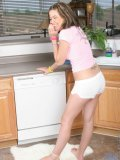 Innocent brunette starts to get naughty while shes cooking in the kitchen
