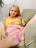 Flirt cutie teen smiling lively as she flashes her soft delicate body on couch