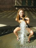 Gorgeous teen plays in the water on a hot day