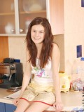 Topless teen brunette took time to relax and strip in the kitchen counter