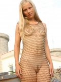 Only wearing a see thru net dress ljuba looks absolutely beautiful