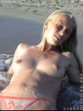 Teen nubile ljuba gets all wet in the ocean and probably has sand all over the place