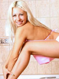 Charming amateur blonde Lynx pampers her smooth tempting body in the bathtub totally naked