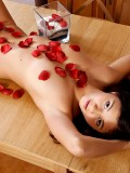 Sexy Malina looks hot and tempting as she brags her naked body on the table with those rose petals