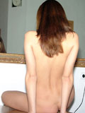 Bored teen strips then fantasizes in the mirror