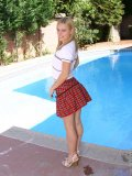 Blonde cute teen goes topless and is taking her panites off dont miss out