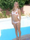 Blonde teen slowly takes off her bikini and poses outdoors