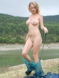 Big titted milana enjoys nature tripping and posing nude in the wilderness