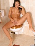 Wow this girl is fucking sweet check out mili in the bathroom she has some great tits she plays with