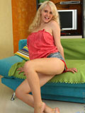 Check out lovely Misha while she pleasures her pink pussy with her legs widely spreads on the sofa