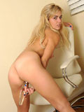 Long haired blonde Misti Love bares off her juicy Nubile assets and posing outside