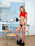 Nataria gently fingers her tight pink snatch in the kitchen to satisfy her sexual urge