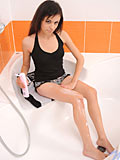 Seductive babe Nikki masturbates with a dildo inside her bathroom