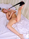 Nubile Oksana strips off her lingerie for a mouthwatering view of her pussy