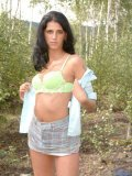 Hot tempting tennager caressing her petite boobs in the forest