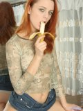 Cute redhead olive plays around with a banana and then eats it