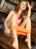 Check out this redhead euro girl just doing her thing topless and teasing her panties